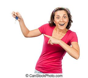 Pretty girl happy with car keys