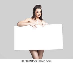 Pretty girl holding a white message board