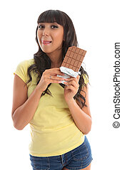 Pretty girl holding chocolate licking lips