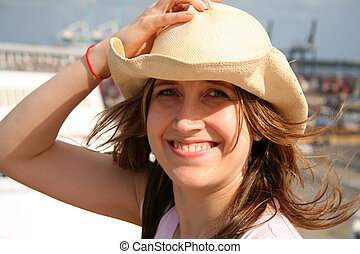 Pretty Girl holding Hat