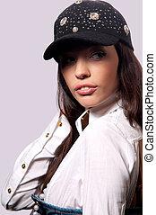 girl in a baseball cap