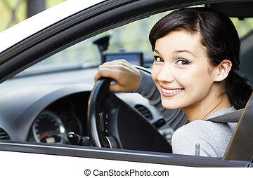Pretty girl in a car