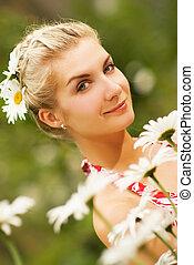 Pretty girl in a chamomile field