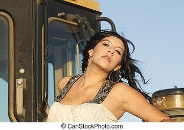 Pretty girl in a construction site