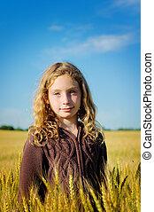 pretty girl in a wheat field