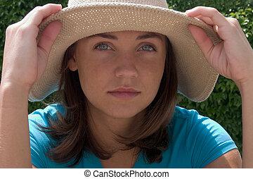 pretty girl in blue wearing hat