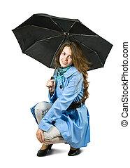 girl in cloak with umbrella.