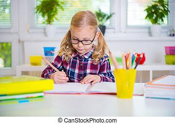 Pretty girl in glasses learns at school - Pretty diligent...