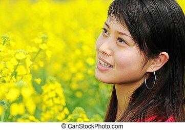 pretty girl in rape flowers