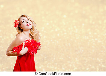 Pretty girl in red dress excited on bokeh lights background