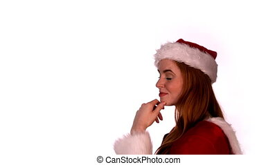 Pretty girl in santa costume smiling at camera in slow ...