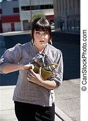 Pretty girl in the city searches purse.