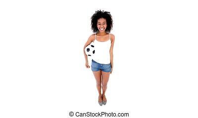 Pretty girl in white holding football on white background