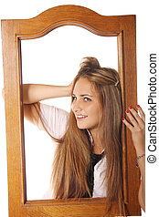 Pretty girl in wooden frame
