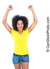 Pretty girl in yellow tshirt and denim hot pants cheering at...