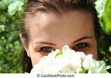 Pretty girl Inhales aroma of flower