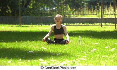 Pretty Girl is doing Yoga in Park.