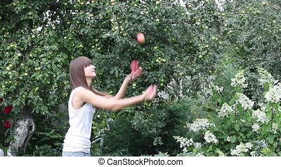 Pretty girl juggling with apples - Pretty girl juggling with...