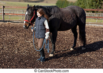 Pretty girl leading her horse - Pretty young girl leading...