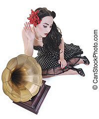 pretty girl listening music on old gramophone isolated on ...