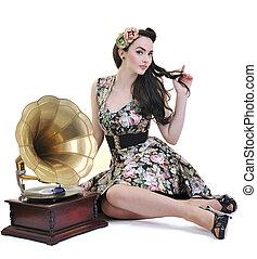 pretty girl listening music on old gramophone