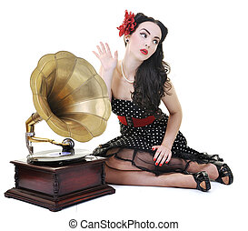 pretty girl listening music on old gramophone isolated on...