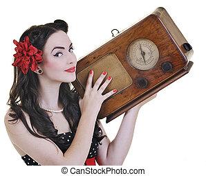 pretty girl listening music on radio isolated on white in studio