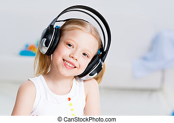 Pretty girl listening to music on headphones - Pretty girl...