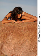 Pretty Girl Lying On Rock