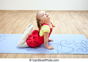 sporty kids making handstand position in gym preteen boys