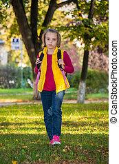 Pretty girl of school age in the autumn park. - Portrait of ...