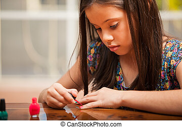 Pretty girl painting her nails