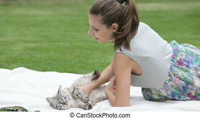 pretty girl playing with cat