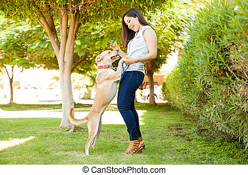 Pretty girl playing with her dog