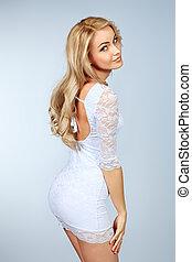 pretty girl - Portrait of a pretty blonde woman posing over ...