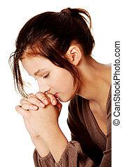 Pretty girl praying.