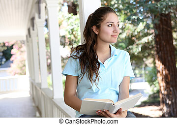 Pretty Girl Reading on Home Porch