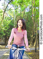 Pretty girl riding a bike and enjoy free time