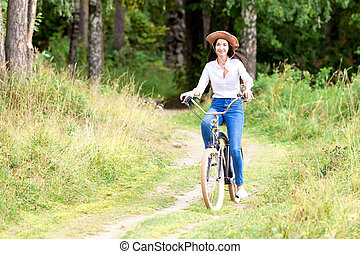 Pretty girl riding on a bicycle