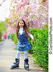 pretty girl rollerblading on spring street