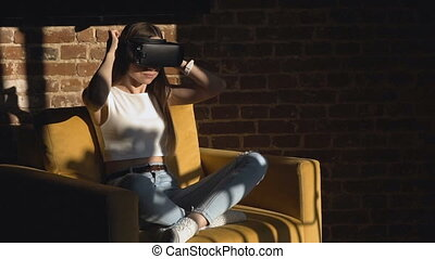 Pretty Girl Sets Virtual Reality Helm - Dark hair caucasian...