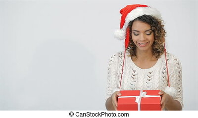fc49db0c40d28 Pretty girl shaking christmas gift. Pretty girl shaking christmas gift. Smiling  happy girl on white background. Beautiful woman ...