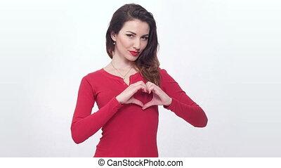 pretty girl showing heart shape