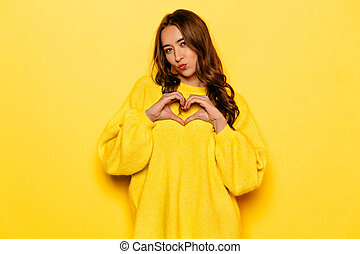 Pretty girl showing love sign with two hands