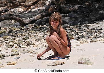 Pretty girl sitting on the beach