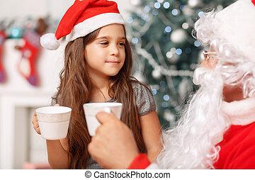 Pretty girl sitting with Santa
