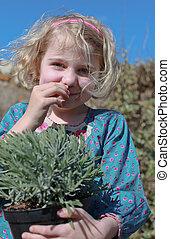Pretty girl smelling lavender