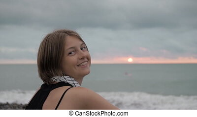 Pretty girl smiles at sunset by the sea - Georgia