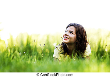 Pretty girl smiling - Pretty smiling girl relaxing outdoor