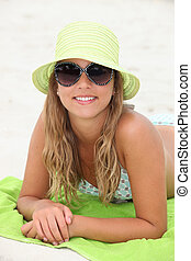 Pretty girl suntanning at the beach